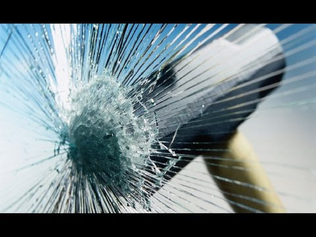 Man Arrested For Smashing At Least 15 Glass Panels Of Lift Door At